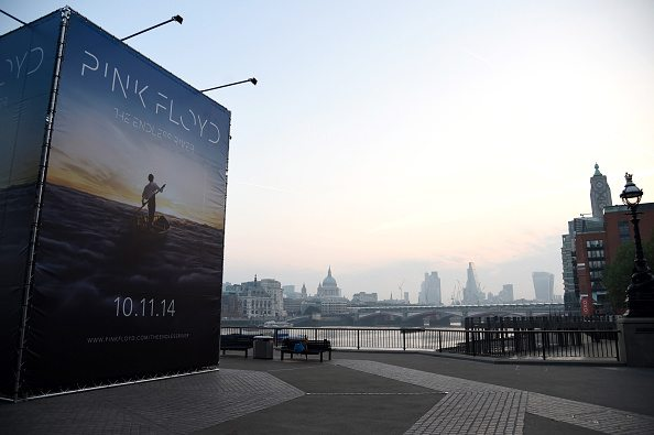 LONDON, ENGLAND - SEPTEMBER 23:  Pink Floyd reveal album details and artwork for new album 'The Endless River' on South Bank along the Thames on September 23, 2014 in London, England. The concept for the powerful imagery of a man rowing on a river of clouds was created by Ahmed Emad Eldin, an 18-year-old Egyptian digital artist. The album will be released on 10 November 2014  (Photo by Ben A. Pruchnie/Getty Images for Warner Music)